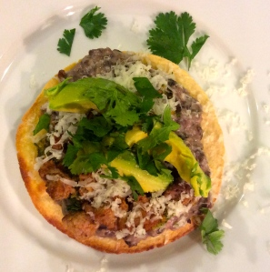 Tostada with beans and spicy meat