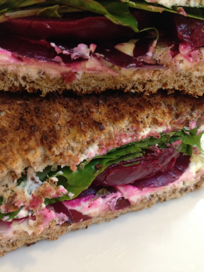 Pickled beet and goat cheese sandwich with arugula