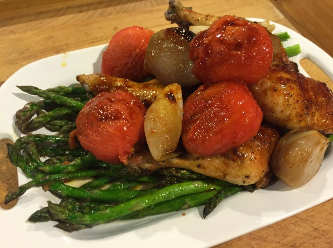 Chicken with asparagus, tomatoes, and shallots.