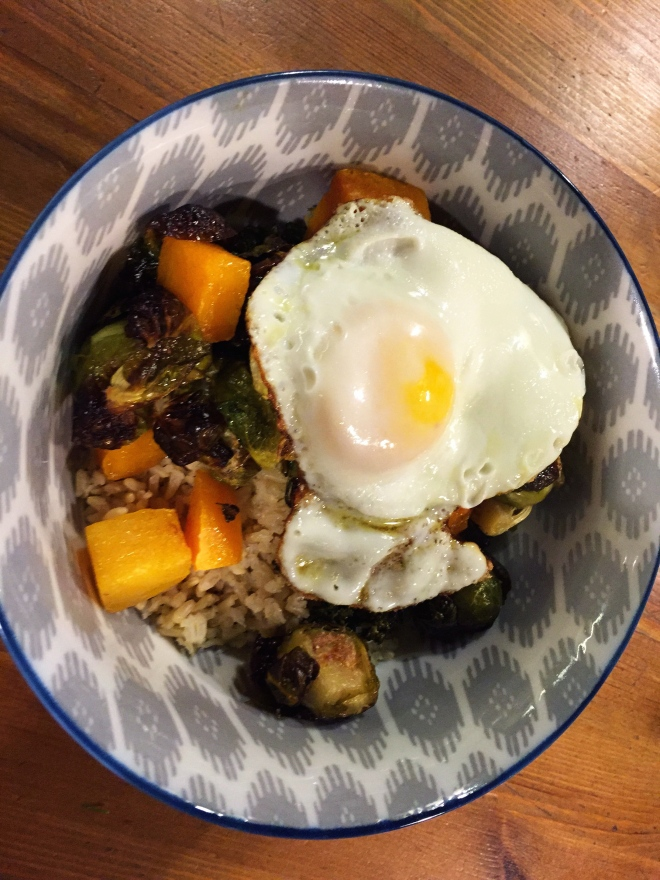 Rice bowl with roast butternut squash, Brussels sprouts and fried egg